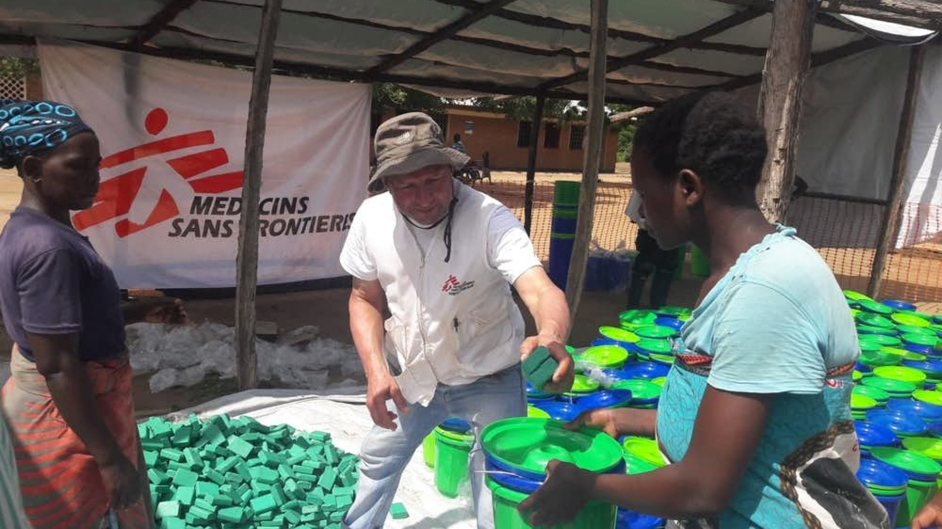 MSF staff handing out water and sanitation supplies in Malawi
